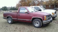 red single cab pickup truck 796 mi