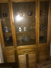 brown wooden framed glass display cabinet Ypsilanti, 48198