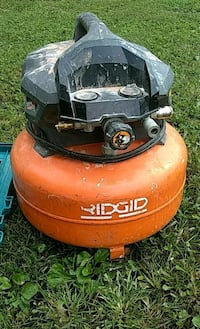 orange and black Ridgid air compressor 55 km