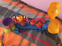 blue, yellow, and red plastic toy Granby, J2G