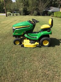 green and yellow John Deere ride on lawn mower Lawrenceville, 30045