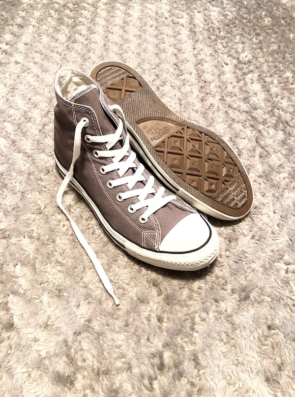 Converse All-Stars paid $56 size 10 men size 12 women Classic Chuck Taylor hi-top. Color grey. Boasts a durable canvas upper, cotton laces, a padded