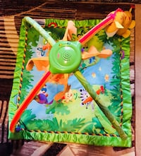 baby's green and yellow activity gym