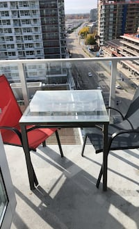 Table and chairs. Steel and glass table Richmond, V7C 0B5