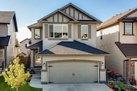 White and gray 2-storey house with garage Calgary, T2H 3C1