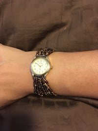 round gold-colored analog watch with link bracelet Airdrie, T4A 2G8