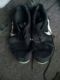 pair of black-and-white Nike running shoes Winnipeg, R2W 5A8