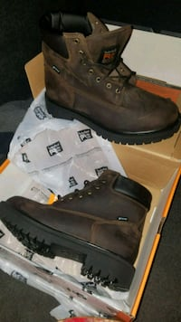 pair of brown leather work boots with box 2215 mi