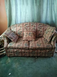 brown and red floral 3-seat sofa