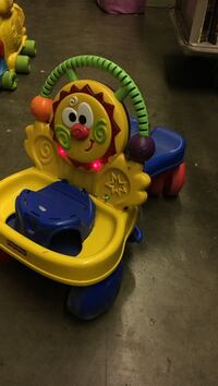 yellow and blue Fisher-Price ride-on toy Saint Peters, 63376