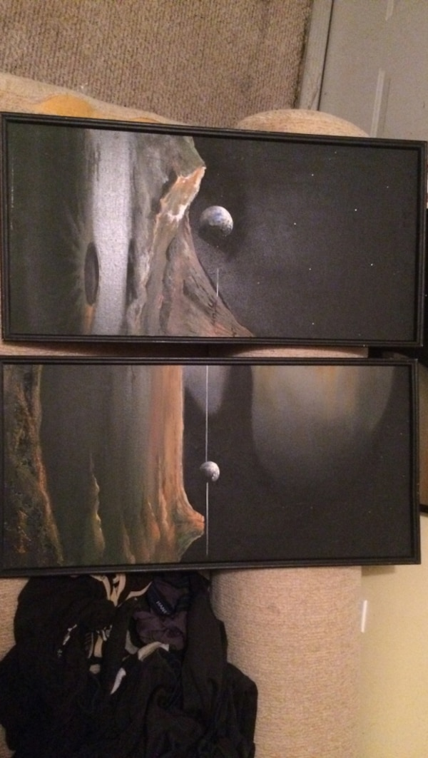 Two black wooden painting frames