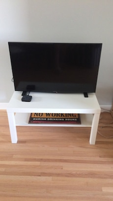 black flat screen tv and white tv stand