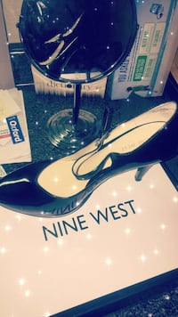 unpaired black Nine West leather heeled shoes with box