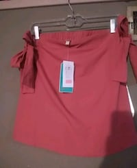 Rose colored skirt with bows on the side  Size XS Omaha, 68104