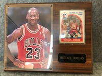 1989 NBA ALL-Star Game card framed with a picture of Michael Jordan. Picture has slight cracking at top corners as indicated in second picture.  10x8 in. wood frame  Del Mar, 92014