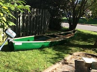 green canoe with outboard motor