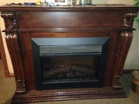 Brown wooden framed electric fireplace 49 km