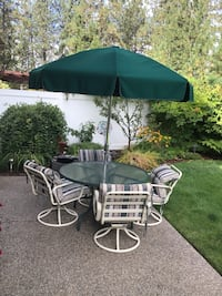 white metal framed glass top patio table with chairs Spokane, 99208