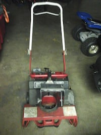 red and black snow thrower