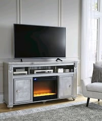 Zolena Champagne LG TV Stand with Glass/Stone Fire Houston