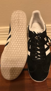 pair of black-and-white Adidas sneakers. Women's size 10 worn 3 -5 Times