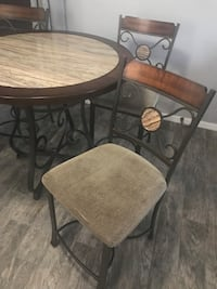Round brown wooden table with four chairs. Bar high  Bradenton, 34203