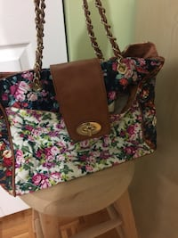 black, pink, and green floral tote bag 797 km