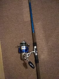 blue and black fishing rod with reel