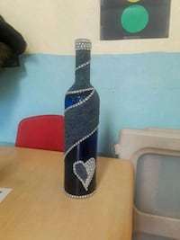 blue and gray glass bottle