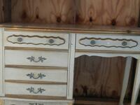 white and brown wooden single-pedestal desk