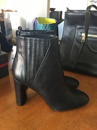Pair of black leather heeled booties size 10 Mississauga, L5A 2H5