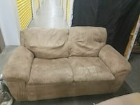 tufted brown fabric loveseat
