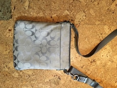 gray and black Coach leather sling bag