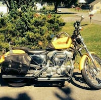 yellow and black cruiser motorcycle
