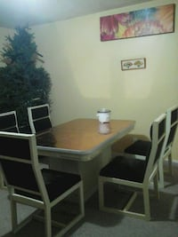 rectangular brown wooden table with six chairs din 3128 km