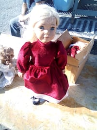 Porcelain Doll in Red Dress