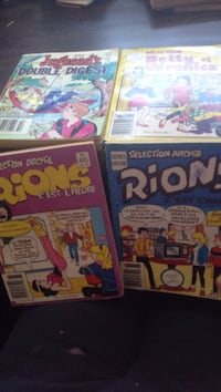 four assorted comic books