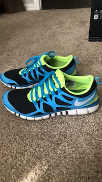 pair of blue-and-green Nike running shoes Delray Beach, 33484