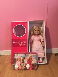 American Girl doll wearing pink dress