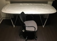 White table and black rolling chair 2270 mi