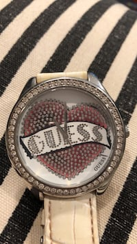 Round silver and diamond encrusted guess analog watch with white leather strap
