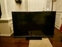black flat screen TV with remote Manassas, 20110