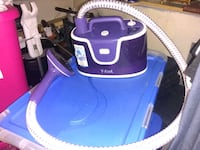 blue and white canister vacuum cleaner Vancouver, V6B 1T5