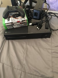 black Xbox One with controller and game cases 43 mi