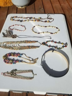 Assorted necklaces and fashion belts