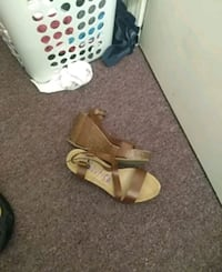 pair of brown leather open-toe wedges 2403 mi