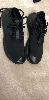 pair of black Nike running shoes Surrey, V3S 8W8