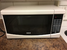 white and black RCA microwave