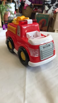 red and white plastic fire truck toy