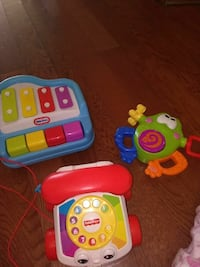 toddler's three Fisher-Price musical learning toys